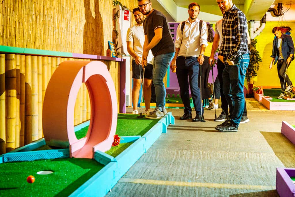 young men playing crazy golf
